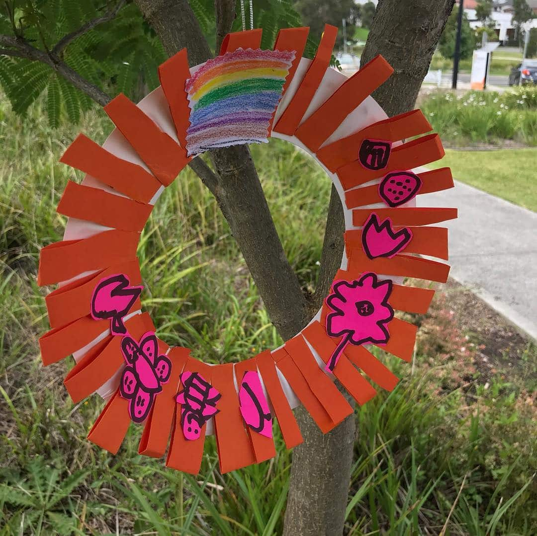 A red crafted Christmas wreath created by our students at one of our art sessions | LesPetitsPainters.com.au