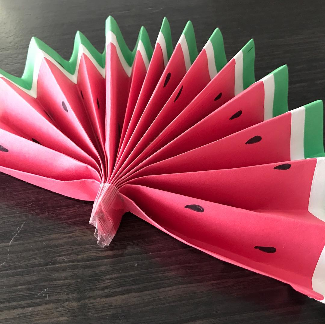 A watermelon paper fan made by kids at one of the art classes by Les Petits Painters