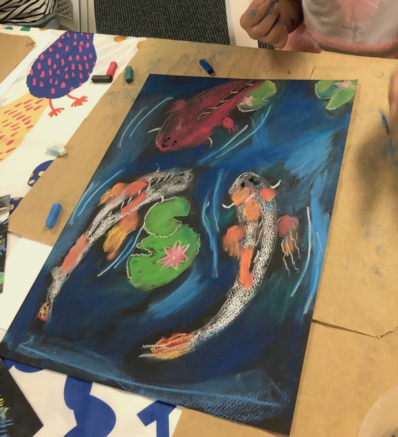 Les Petits Painters art classes for children koi pastel drawing and shading
